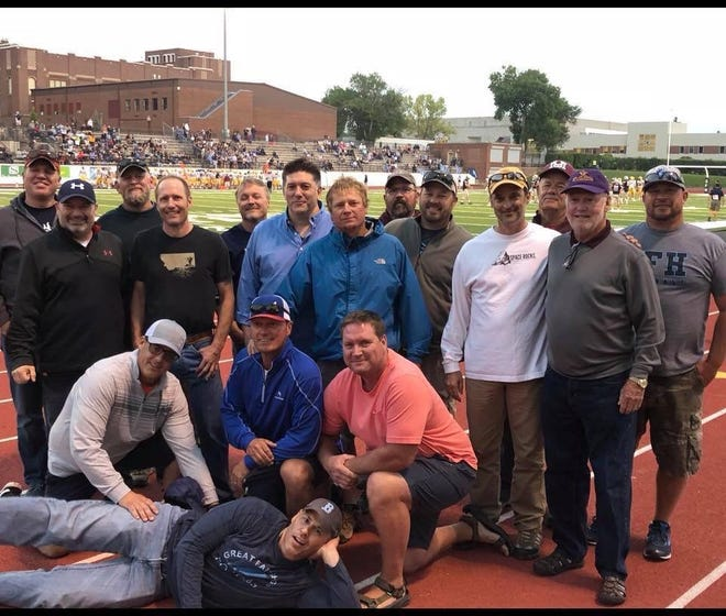 Members of the 1988 state champion Great Falls High football team gathered last Friday night at Memorial Stadium. Pictured are, Vince Kornick (in front), front row from left, Josh Wanago, Brian Plunkett and Stacey Burcham. Back, from left, Trevor Livesay, Mike Howard, Matt Woody, Mark Allen, Jon Dabler, Steve Corda, Matt Willis, Kelly Liscum, Chad Rubino, coach Jim Neilsen, coach Bob Roach, and Jason Newmack.