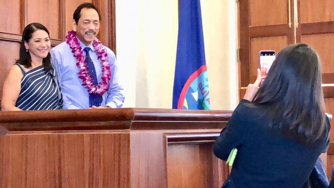 Speaker Benjamin J. Cruz smiles for a photo alongside Sen. Mary Torres at the Guam Legislature on Tuesday, Aug. 28, 2018. Senators took photos with Cruz, on his last day at session before he moves on to his new position as the island's public auditor.