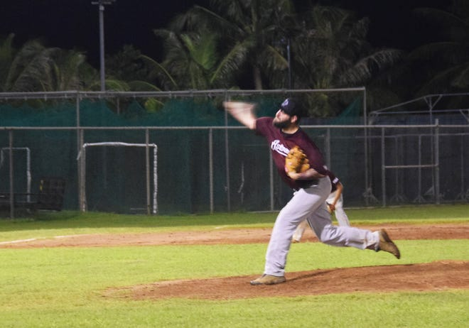 Yigo Astros pitcher Joshua Corpening delivers a pitch during the bottom of the ninth inning in the Astros' GML semifinal playoff game against the Autospot Orioles Tuesday night at the Paseo Stadium. The Orioles lead the series 2-1.