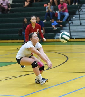 St. John's outside hitter Tylee Shepherd passes the ball during an IIAAG Girls' High School Volleyball match against the John F. Kennedy Islanders in this photo from Aug. 28, 2018.