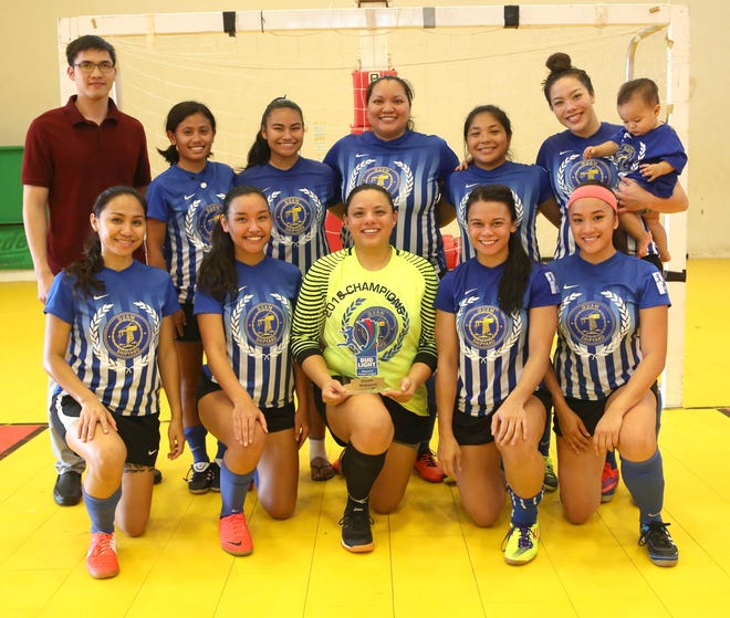Guam Shipyard with the championship trophy of the Bud Light Women's Futsal League during a short awards ceremony following the team's title match against Quality Distributors Sunday at the Guam Sports Complex gym. Guam Shipyard defeated Quality Distributors 4-2.