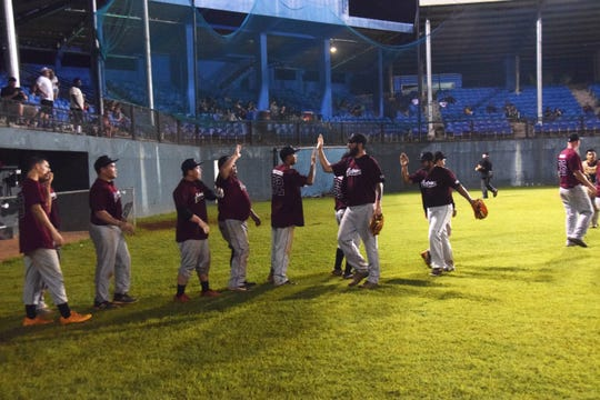 The Yigo Astros celebrate their GML semifinal playoff win against the Autospot Orioles on Tuesday night at the Paseo Stadium. The Astros won Game 3 and the Orioles lead the matchup 2-1 in the best-of-five series.
