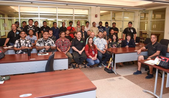 Participants of Guam Community College's Future Builders of Guam Construction Boot Camp gather for a photo with their instructors and construction employers after a brief ceremony at the learning institution in Mangilao on Tuesday, Aug. 28, 2018. Program participants trained for six weeks, in classroom and lab environments, to learn the construction fields of carpentry, welding, electrical, masonry, and plumbing, said Pilar Williams, GCC School of Trades and Professional Services associate dean.