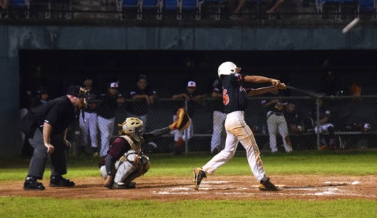 The Autospot Orioles' Gavin Santos hits a ball foul during their GML playoff game against the Yigo Astros Tuesday night at the Paseo Stadium.