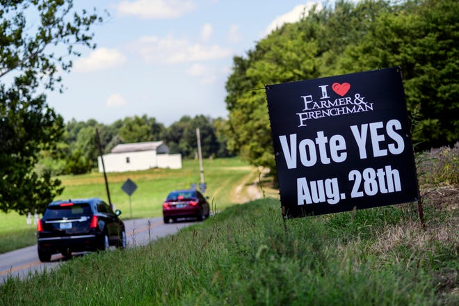 """Signs asking residents to """"vote yes"""" in favor of the Farmer & Frenchman winery ballot initiative line the sides of the roadways in Henderson's Anthoston voting precinct, Tuesday morning, Aug. 28, 2018."""