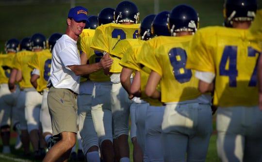 Former Notre Dame linebacker Bob Crable coached high school football at his alma mater, Cincinnati Moeller.