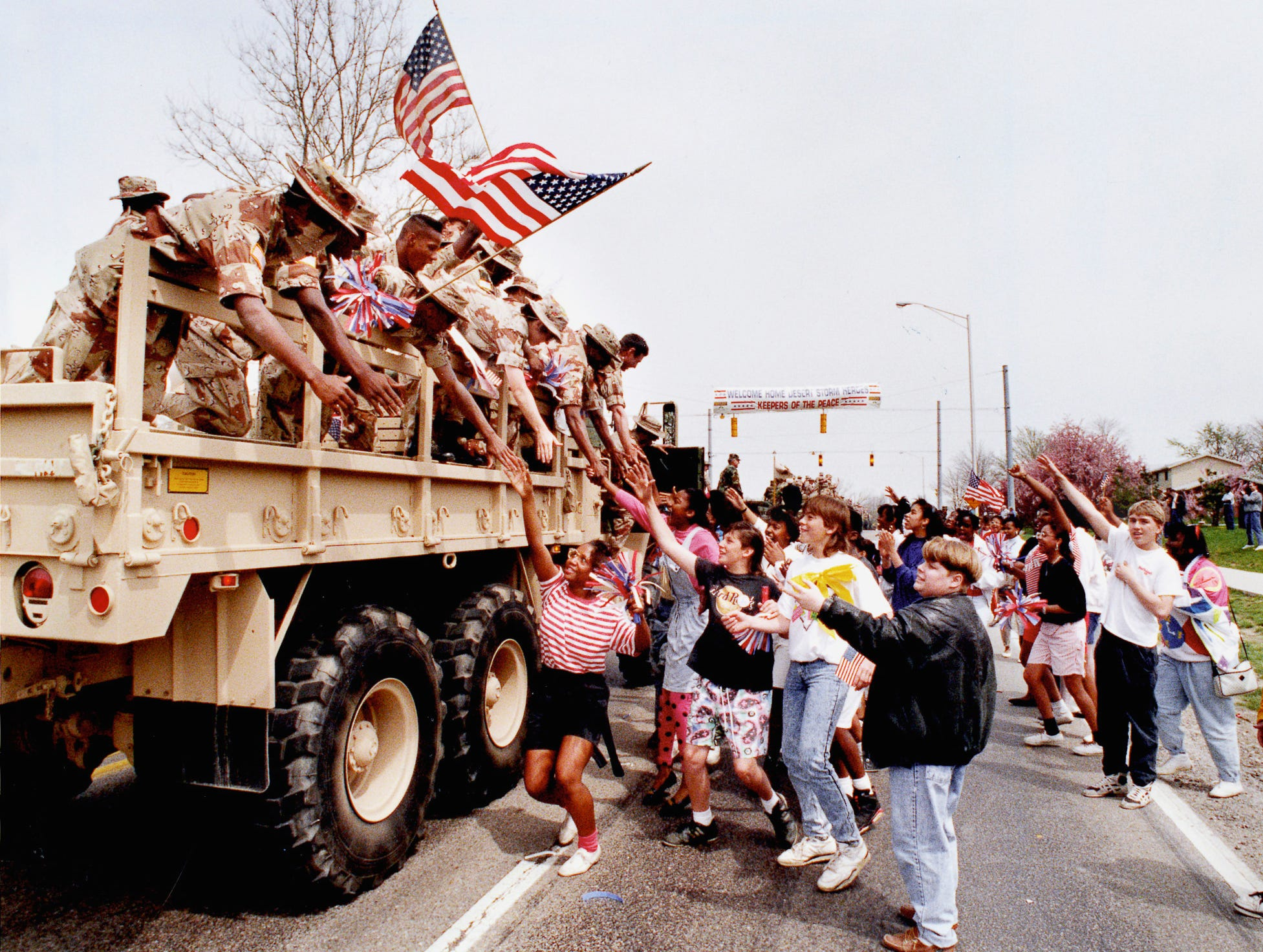 Soldiers returning from the United States' first war in Iraq were met with appreciative cheers from  Lawrence Township students lining the road along East 56th Street. An estimated 6,000 people welcomed 230 Indiana-based Army reservists home from Operation Desert Storm on April 18, 1991 after the fighting ended.