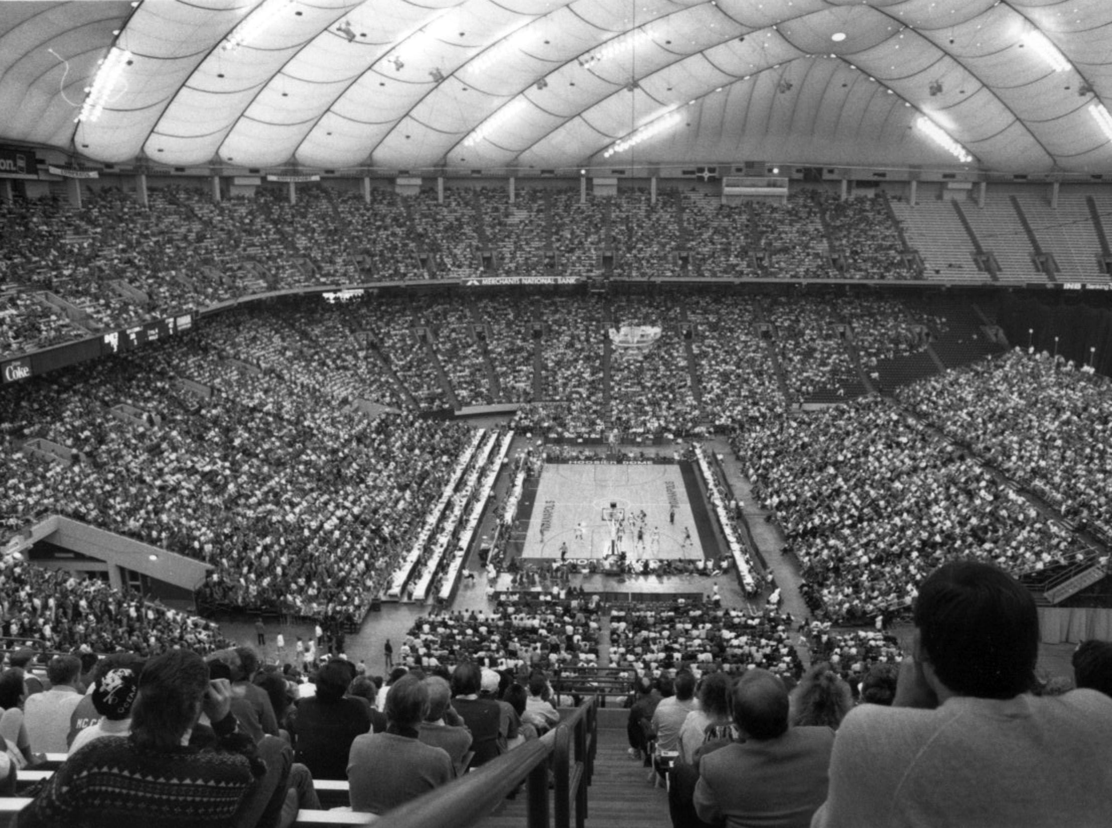 1990 IHSAA basketball finals moved to the then-Hoosier Dome. A national-record high school crowd of 41, 046 was in attendance.  The final game was Bedford North Lawrence (Damon Bailey) vs. Concord.