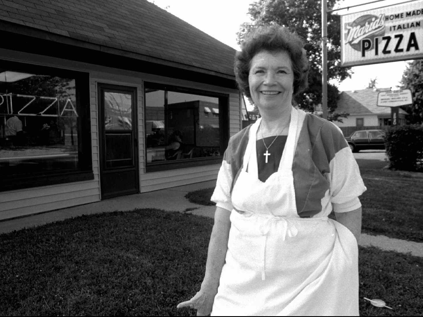 Mary Warble outside her popular Maria's pizza parlor on Shelby Street in 1994.