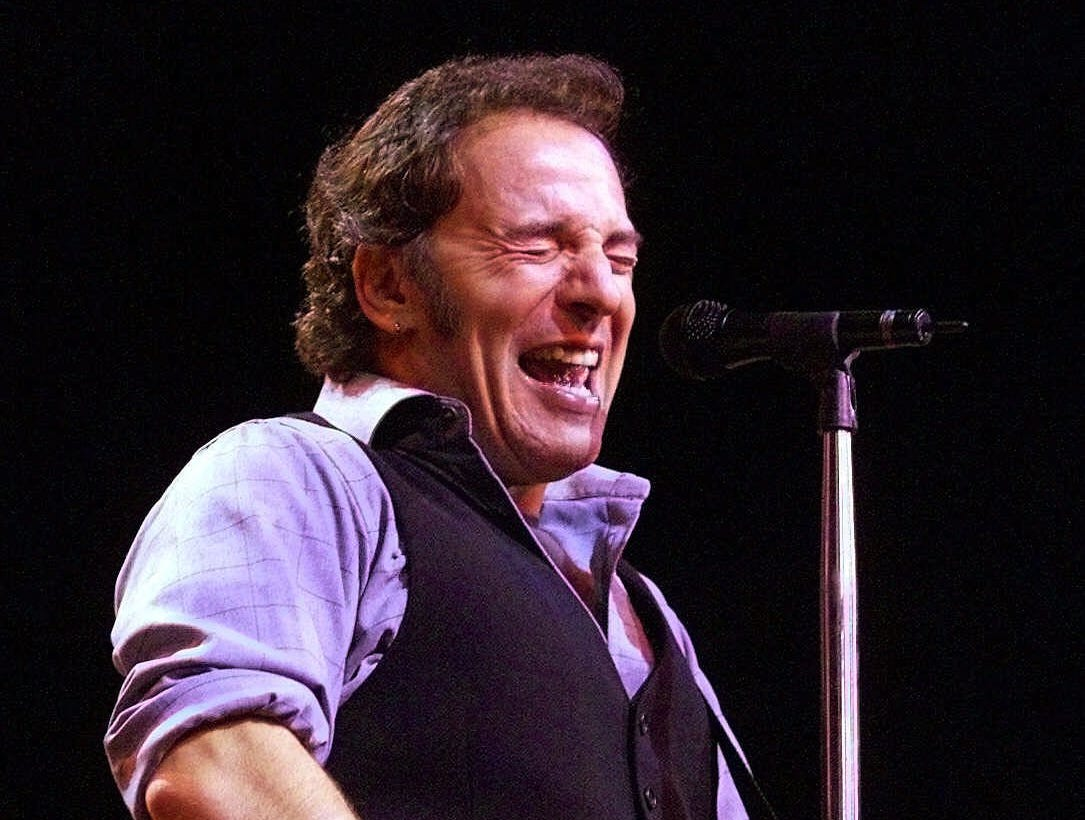 Bruce Springsteen sings to fans at the beginning of his concert with The E-Street Band Wednesday, Nov. 10, 1999 at the Conseco Fieldhouse in Indianapolis.