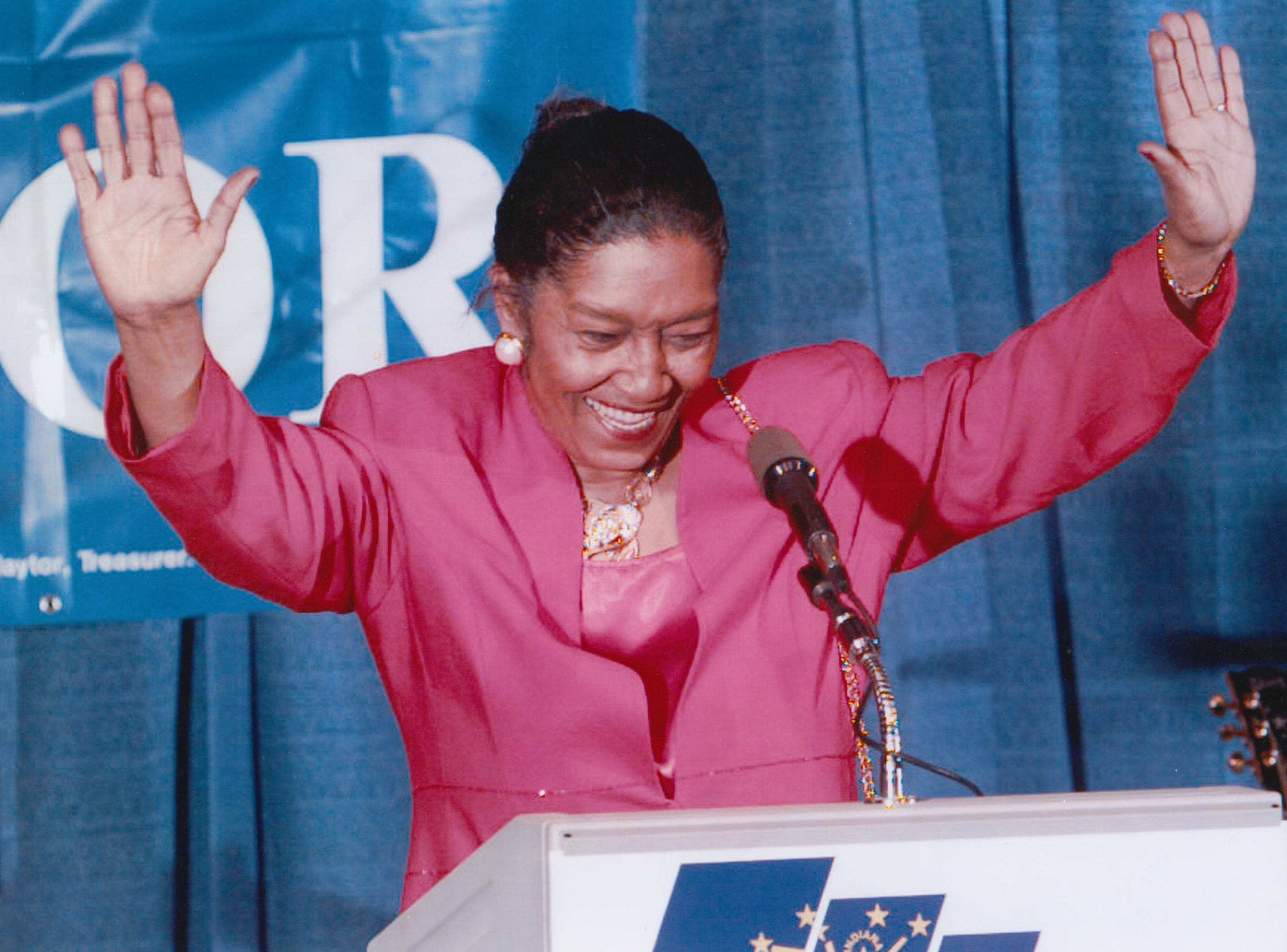 Julia Carson celebrates on stage at the convention center after her 10th Congressional District race victory Nov. 5, 1996