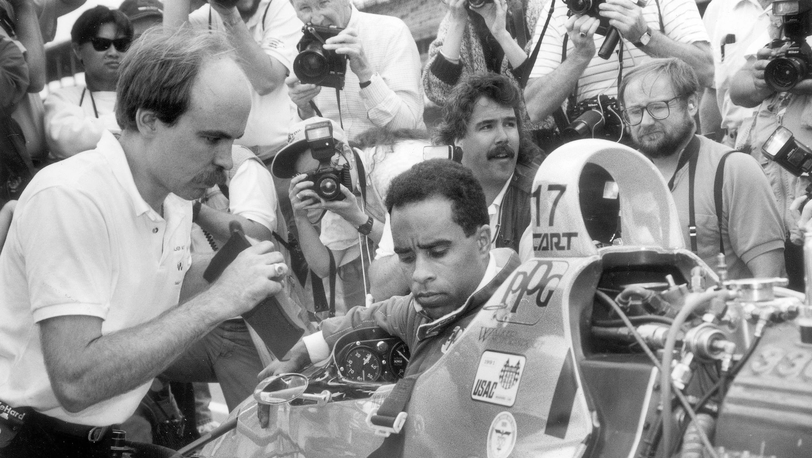 Willy T. Ribbs gets out of his car after his run around the speedway at the Indianapolis Motor Speedway, May 9, 1991. That year, he became the first African-American to qualify for the Indianapolis 500.