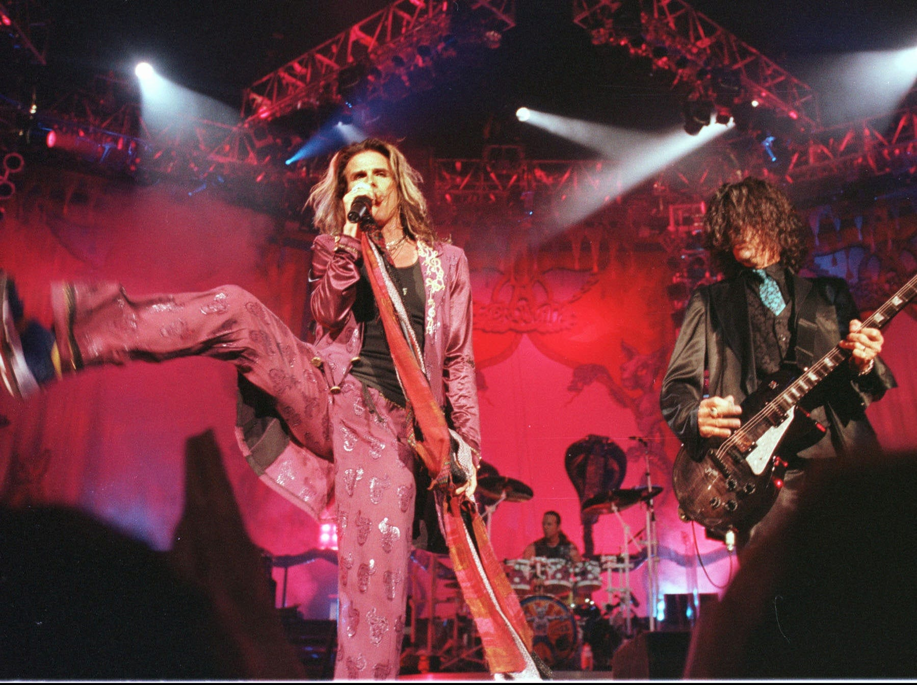 Steven Tyler lead singer (left) and guitarist Joe Perry of Aerosmith, perform at Deer Creek Music Center on Aug. 31, 1997.
