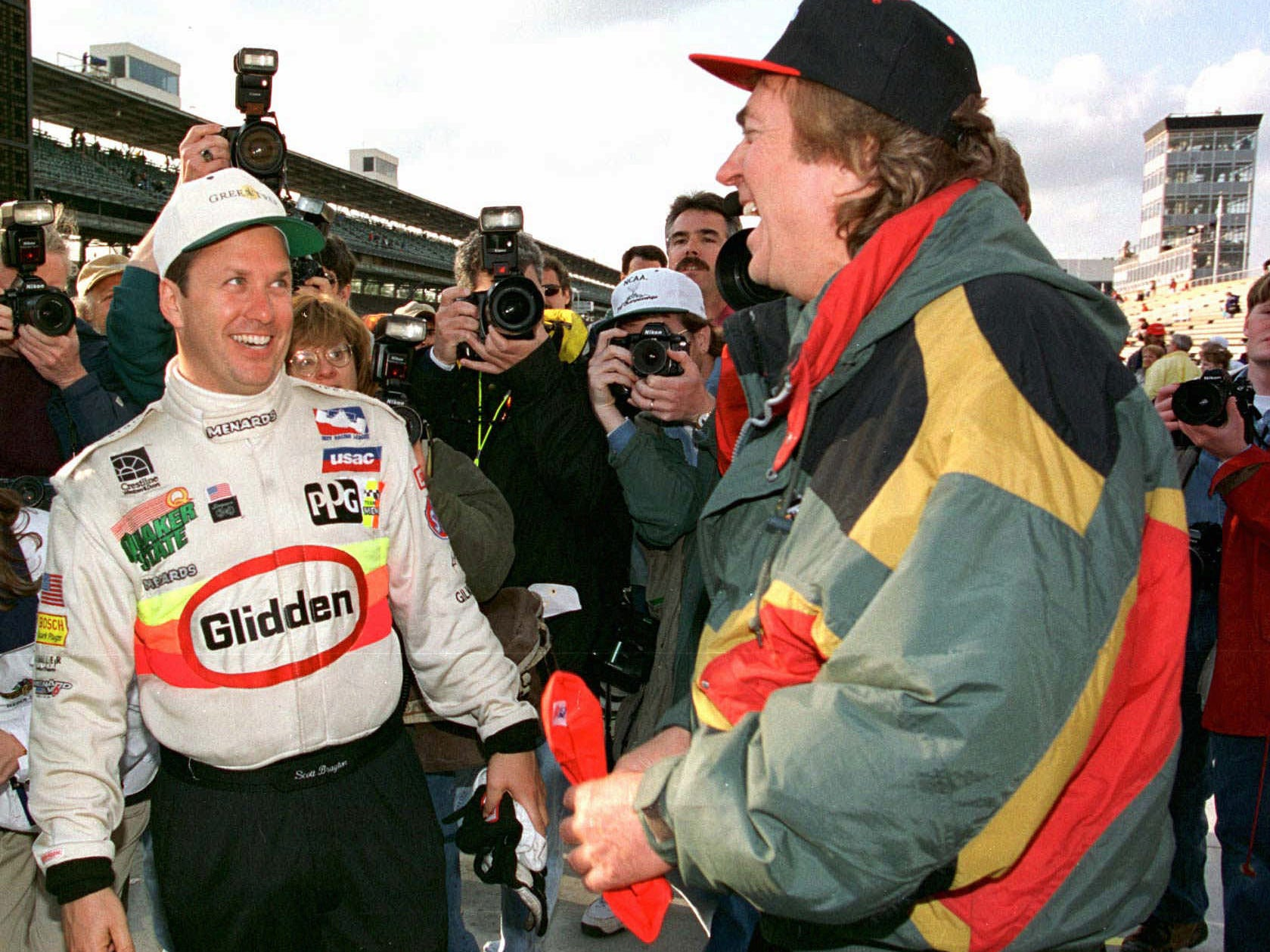 Scott Brayton reacts to team owner John Menard in the pit area after setting a new four lap track record and securing the pole for the 80th running of the Indianapolis 500 in 1996.  Brayton was killed in practice just a few days later.