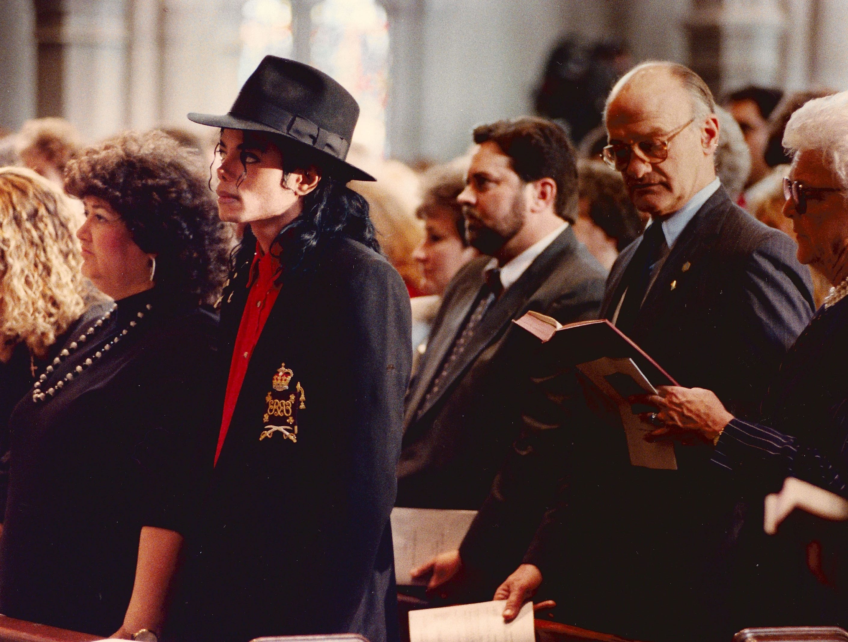 Jeanne White, left, stands with Michael Jackson during the funeral service for Ryan White April 11, 1990,  First Lady Barbara Bush is at far right.