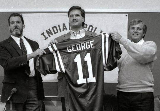 Jim Irsay (left) introduces Jeff George after the quarterback signed with the Indianapolis Colts, April 20, 1990.  Coach Ron Meyer is on the right.