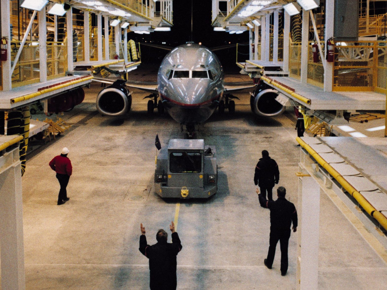 "2/26/94--United Airlines employees guide a 737 into the first hanger at the Indianapolis Maintenance Center on Feb. 26, 1994. The ""fit test"" was to make sure the expensive docks fit closely to the plane, before the first maintenance work began March 28.  Blaming lack of air travel following the Iraq war, United Airlines filed for bankruptcy in 2003. The Indianapolis base officially closed in 2003."