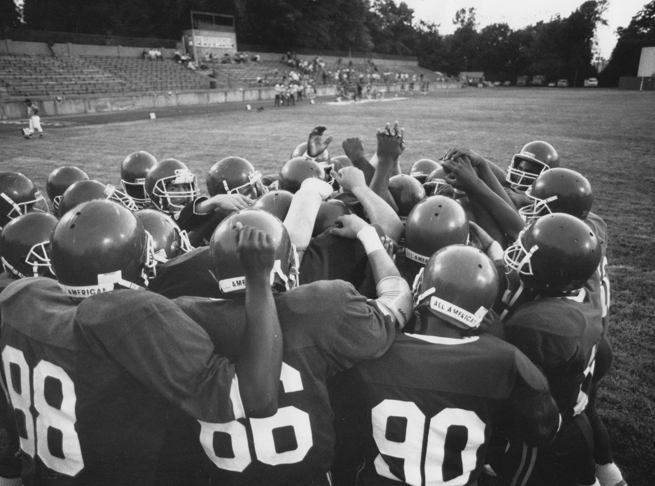 Tech's fooball team huddles together before the start of a game in 1990.
