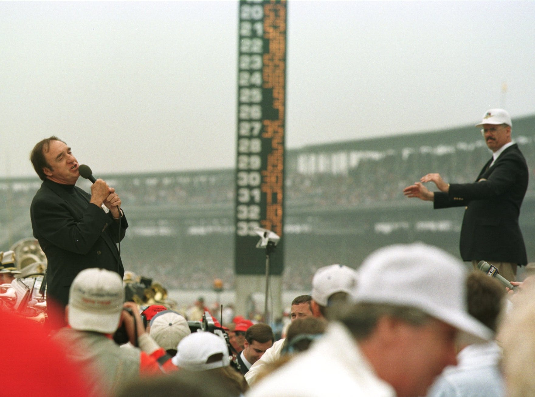 "Entertainer Jim Nabors sings, ""Back Home Again in Indiana"" during prerace ceremonies before the start of the 1998 Indianapolis 500."