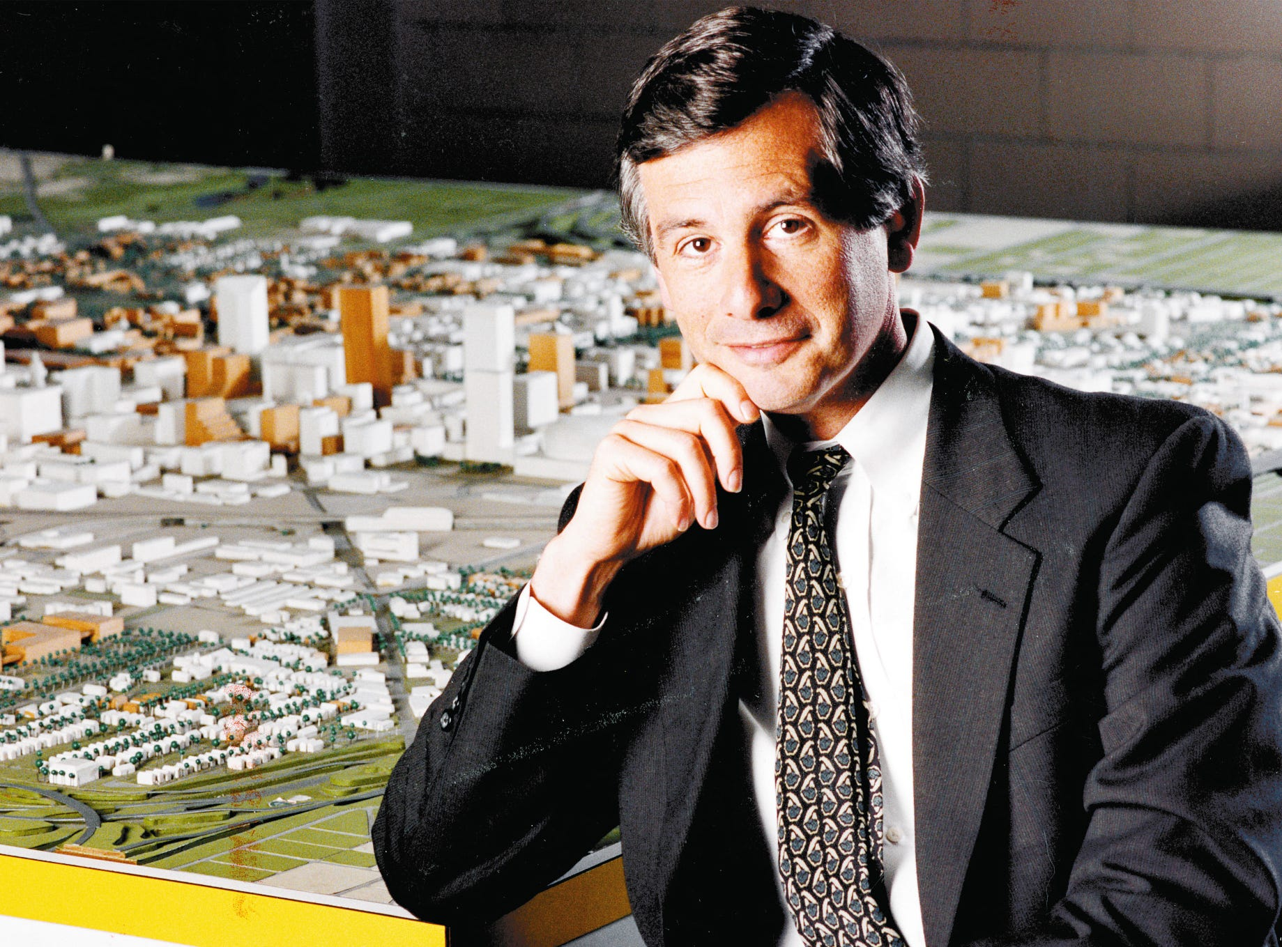 Indianapolis Mayor Stephen Goldsmith poses in front of a scale model of the city on Nov. 21, 1991.