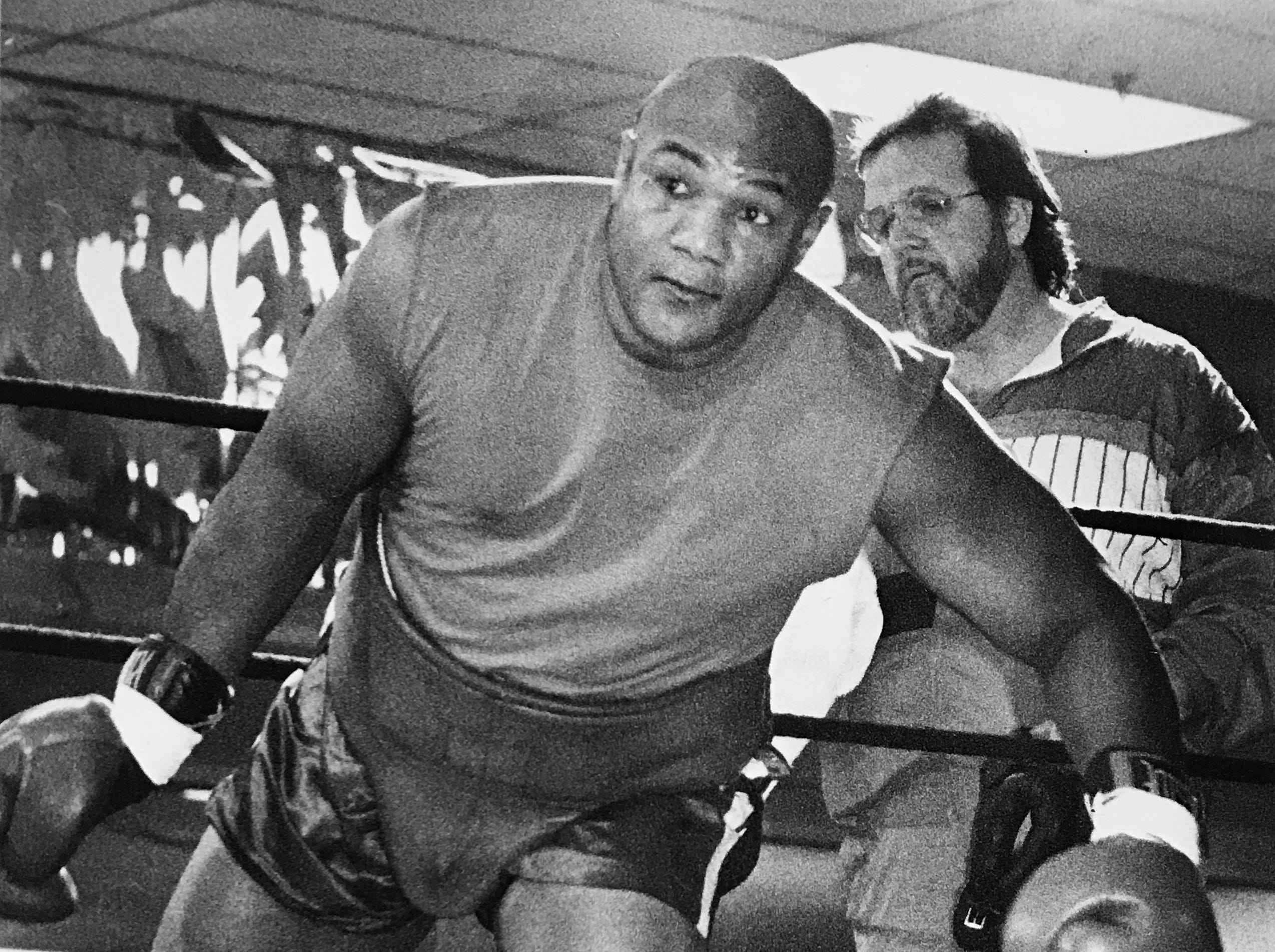 George Foreman steps into the ring for an exhibition bout against FrankfortÕs Rad Brewer at the Sherwood Country Club on the southside on Nov. 21, 1990.
