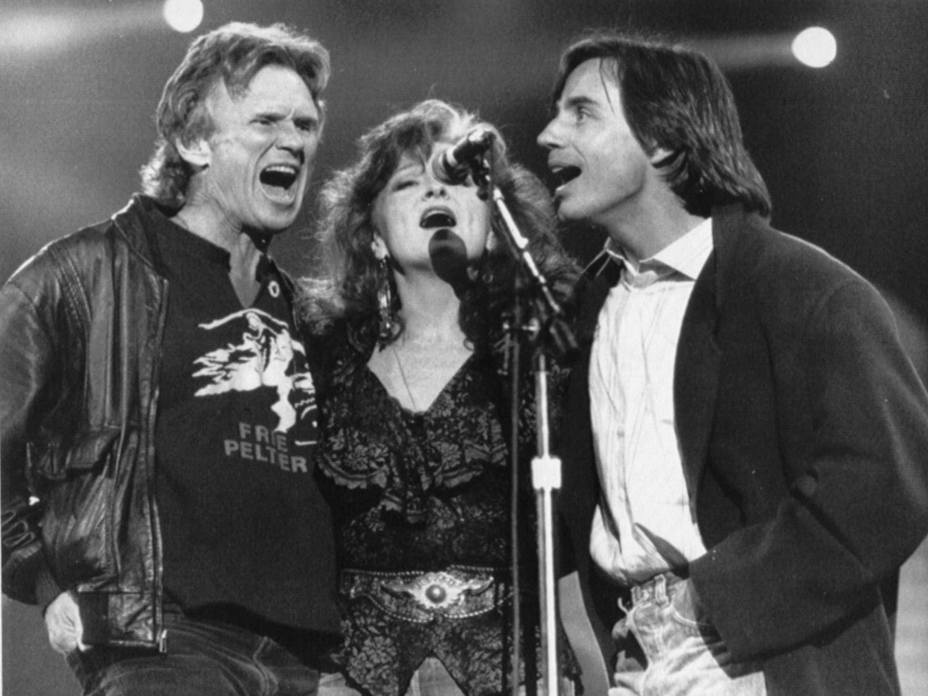 Kris Kristofferson, Bonnie Raitt and Jackson Browne (from left) perform during Farm Aid IV in Indianapolis April 7, 1990.
