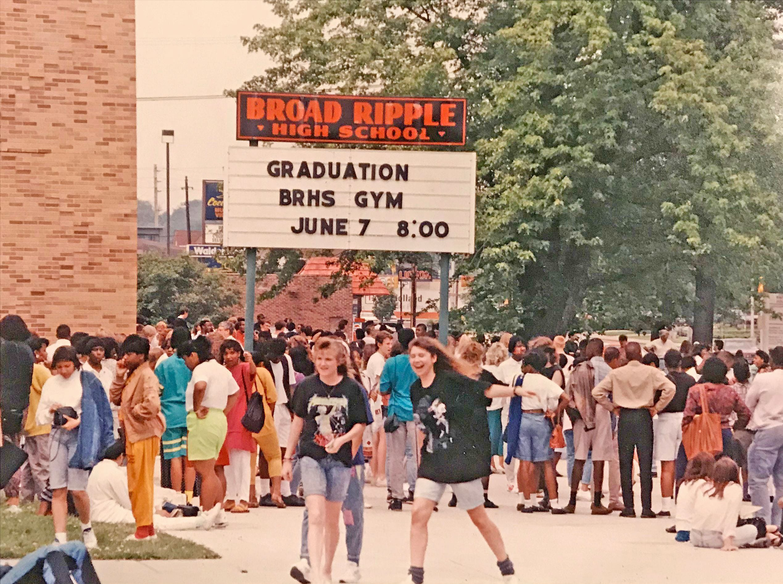 Broad Ripple High School students mill about outside the school after fires were set as pranks forcing an evacuation in 1990.