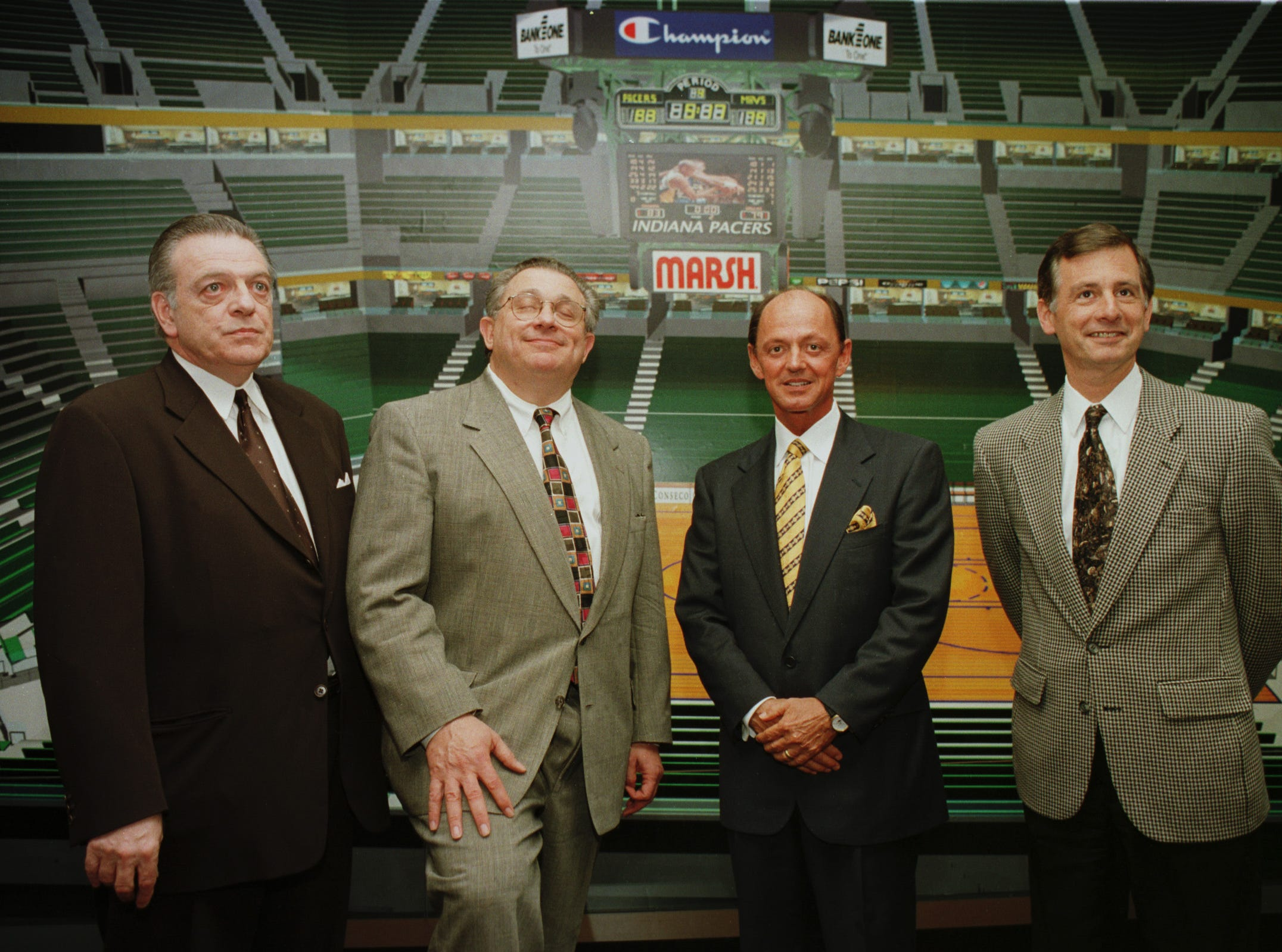 Donnie Walsh, Herbert Simon, Stephen Hilbert and Mayor Stephen Goldsmith pose in front of a mural of the new Pacers home, at the May 22, 1998 announcement of a 20-year agreement between the Pacers and Conseco, Inc. for the naming rights to the PacersÕ new arena, to be named Conseco Fieldhouse.