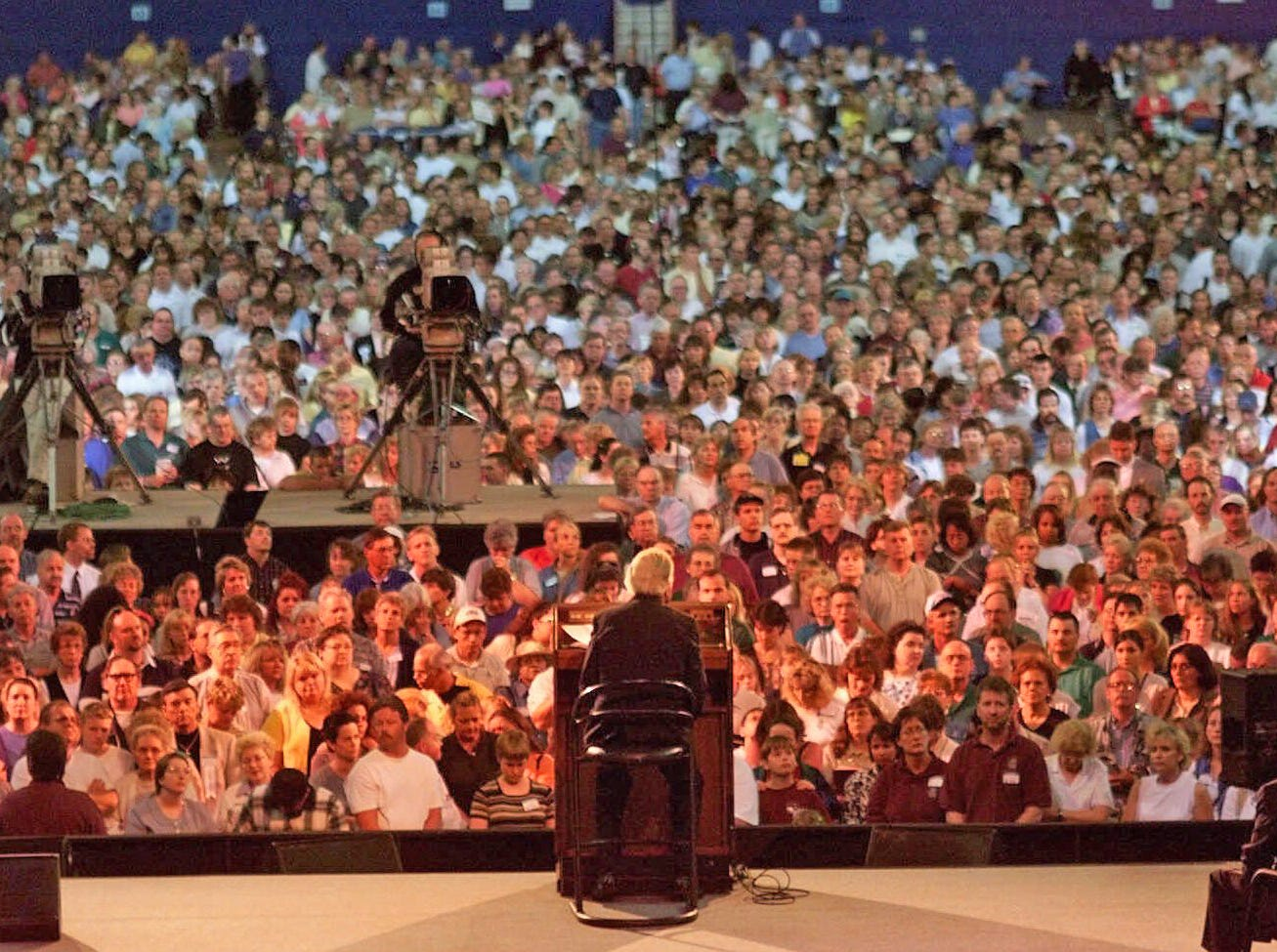 Thousands of Christians converge on the floor of the RCA Dome in Indianapolis, Ind., after being called to the altar by Rev. Billy Graham, center, Friday, June 4, 1999. Graham addressed the crowd on the second night of his Indiana Crusade.
