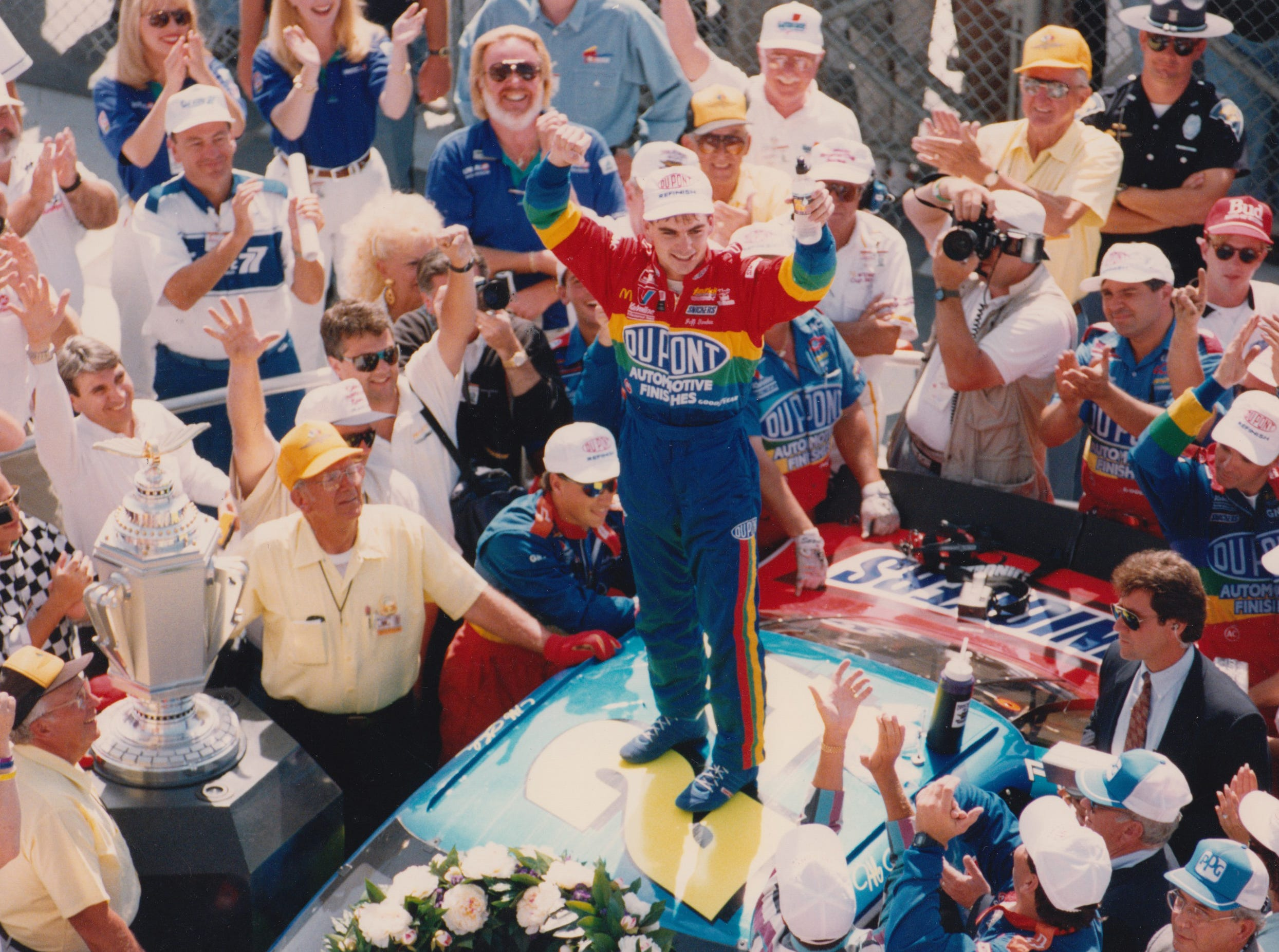 Jeff Gordon celebrates on top of his car after winning the inaugural Brickyard 400 in 1994.