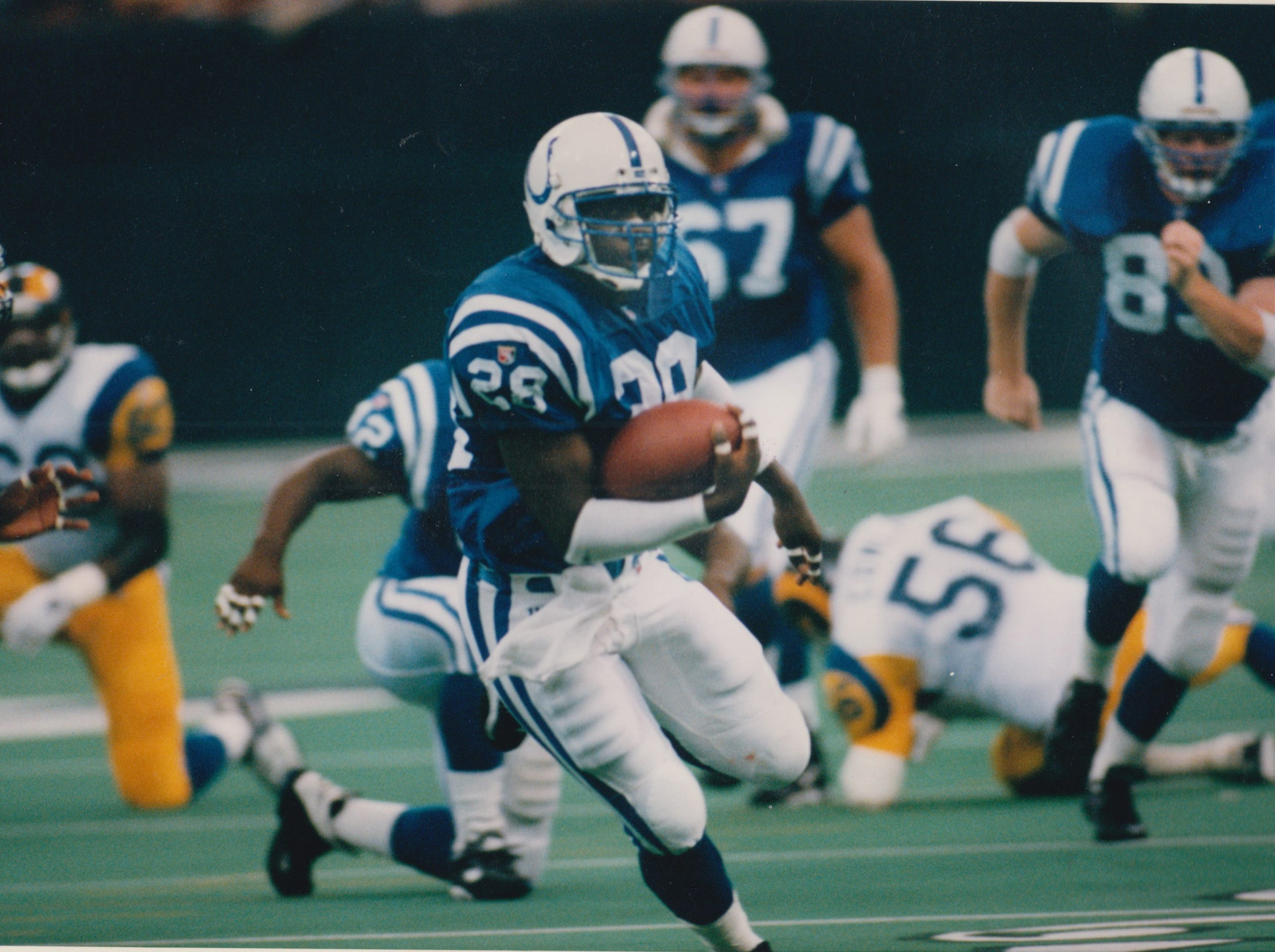 Marshall Faulk breaks free toward his second touchdown run, a 33-yarder that put the Colts up for good against the St. Louis Rams. The Colts won 21-18 in the Oct. 1, 1995 showdown.