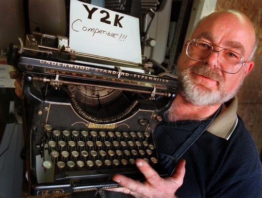 As the world prepared for its computer systems to melt down as we entered 2000, typewriter repairman, Terry Bordon holds a classic 1934 Underwood model 6, manual typewriter he jokingly placed a sign in the carriage that reads Y2K Compatible.