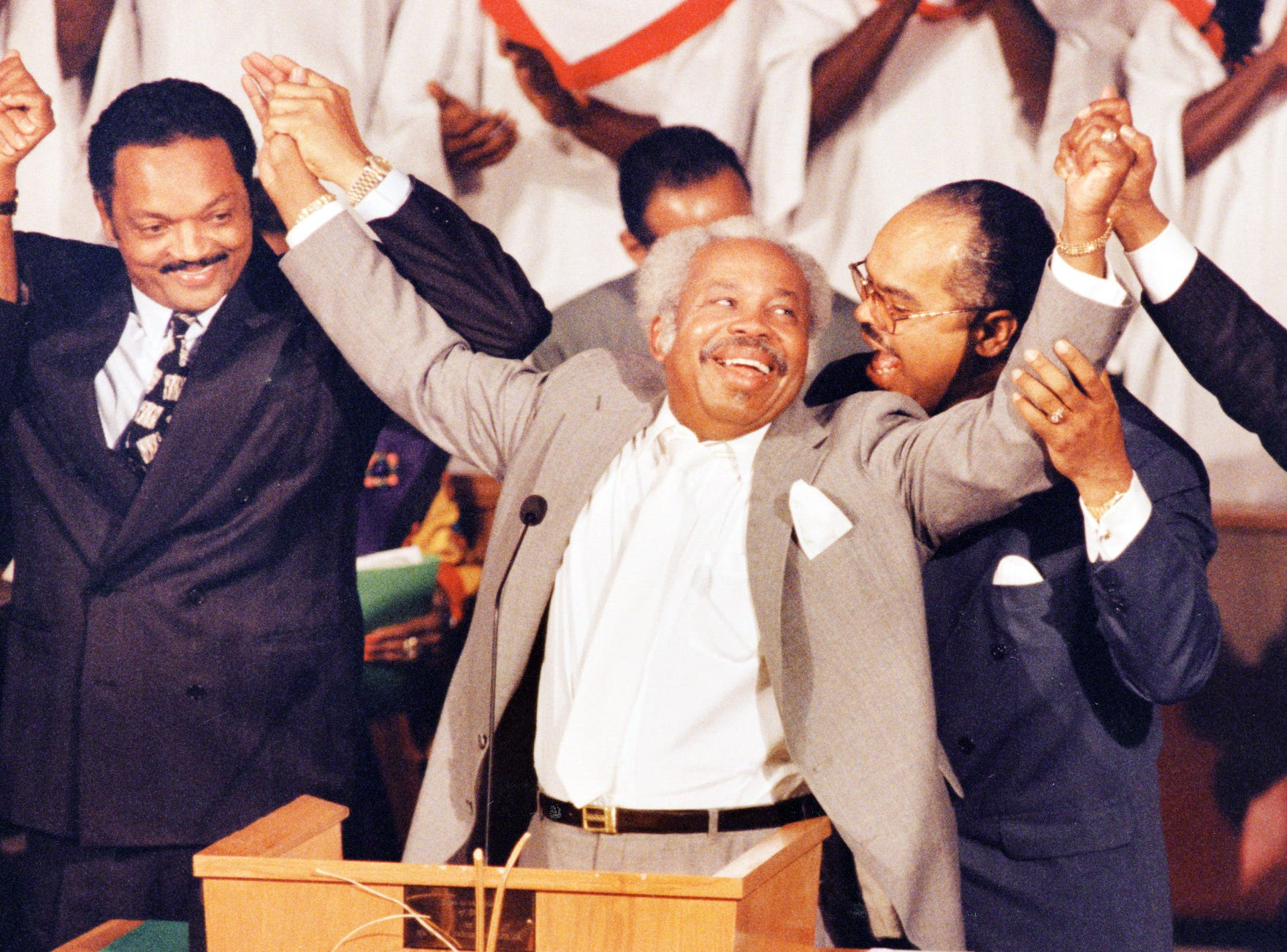 The Rev. Jesse L. Jackson (left) honored Rev. Andrew J. Brown (center) with the PUSH Excellence Award at the Indiana Black Expo Ecumenical Service on July 17, 1991. The Rev. T. Garrott Benjamin, whose Light of the World Christian Church (Disciples of Christ) hosted the service, is shown at right. Widely regarded as the city's foremost civil rights leader, Rev. Brown pastored the St. John Missionary Baptist Church for many years before stepping down in September 1990.