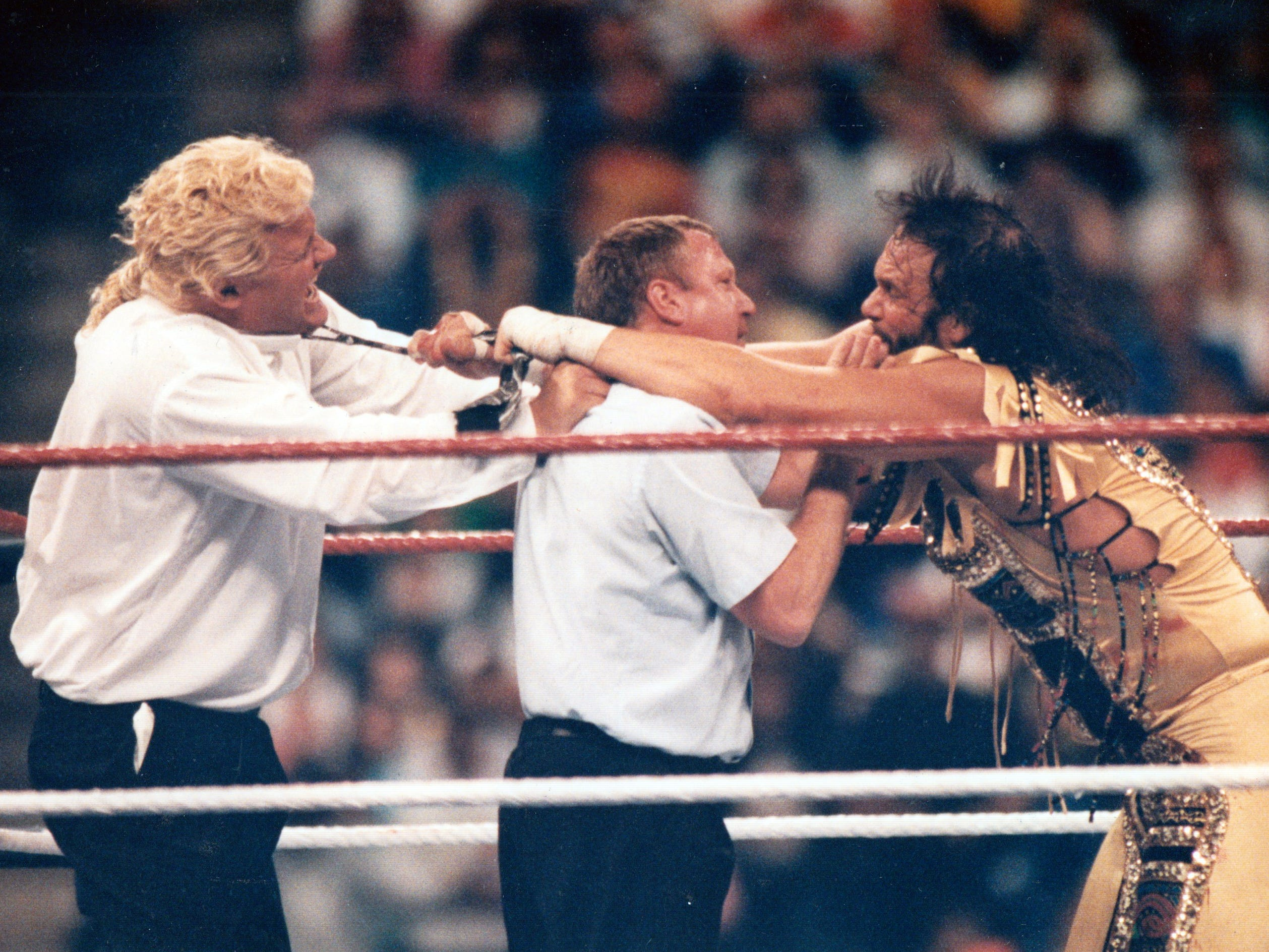 "1992 Wrestlemania at the Hoosier Dome. Macho Man Randy Savage (right) in a battle with ""Mr. Perfect"" left."