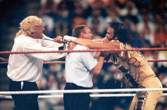 """1992 Wrestlemania at the Hoosier Dome. Macho Man Randy Savage (right) in a battle with """"Mr. Perfect"""" left."""