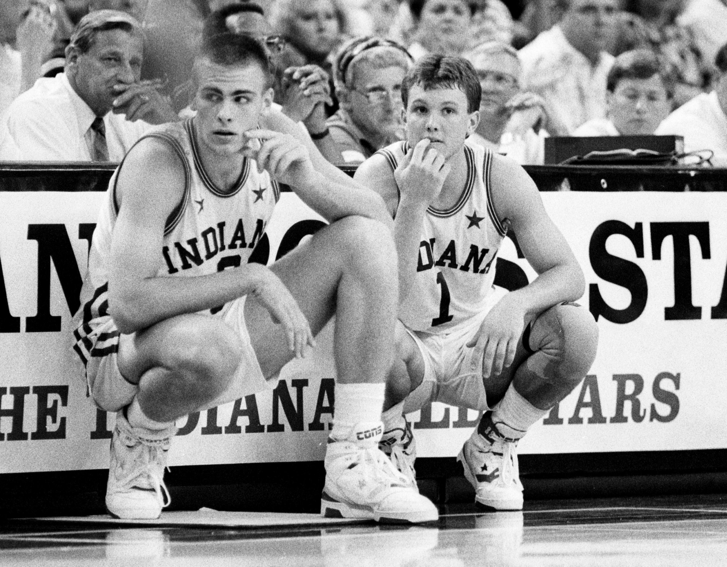 High School basketball stars Eric Montross, left, and Damon Bailey, right wait at halfcourt to enter the game as the Indiana All-Stars take on Kentucky at Market Square Arena in 1990.