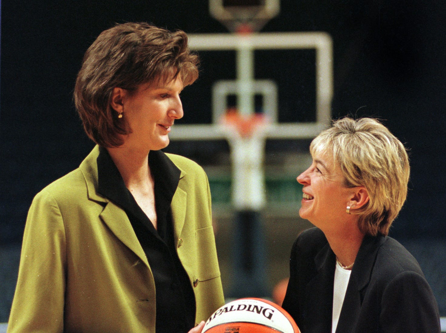 Anne Donovan (left) jokes with Nell Fortner (right), at Market Square Arena, Wednesday, October 20, 1999, while being photographed by the press. Donovan was named today as the interim coach for IndianaÕs WNBA expansion team.  She will be that coach when it begins its season in the summer of 2000.