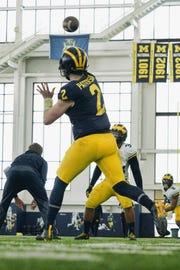 Michigan quarterback Shea Patterson practices in Ann Arbor.
