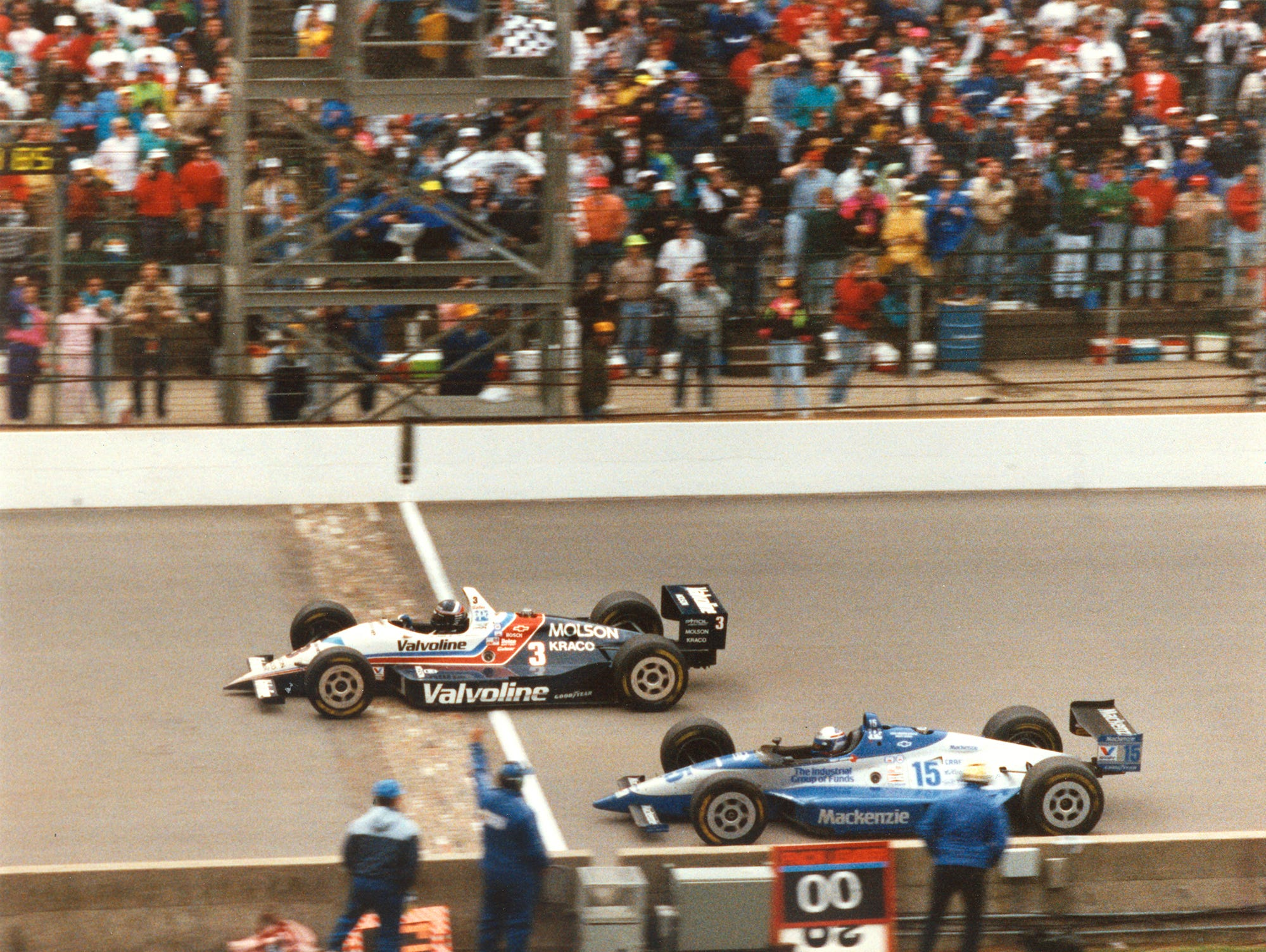 Al Unser Jr. beats Scott Goodyear to the finish line in the closest Indy Car finish in 1992.