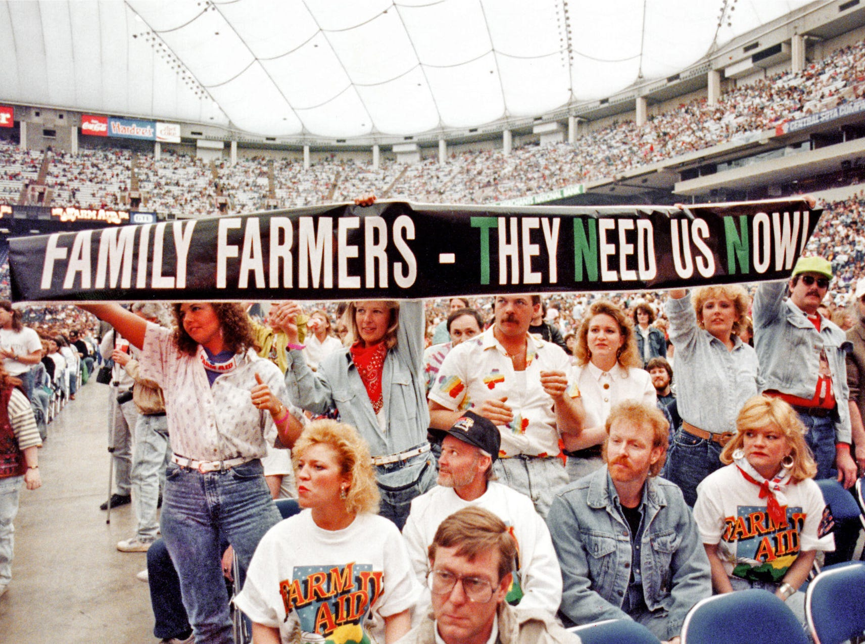 Seventy acts and 45,000 fans in the Hoosier Dome show their support for the Farm Aid IV concert April 7 1990.