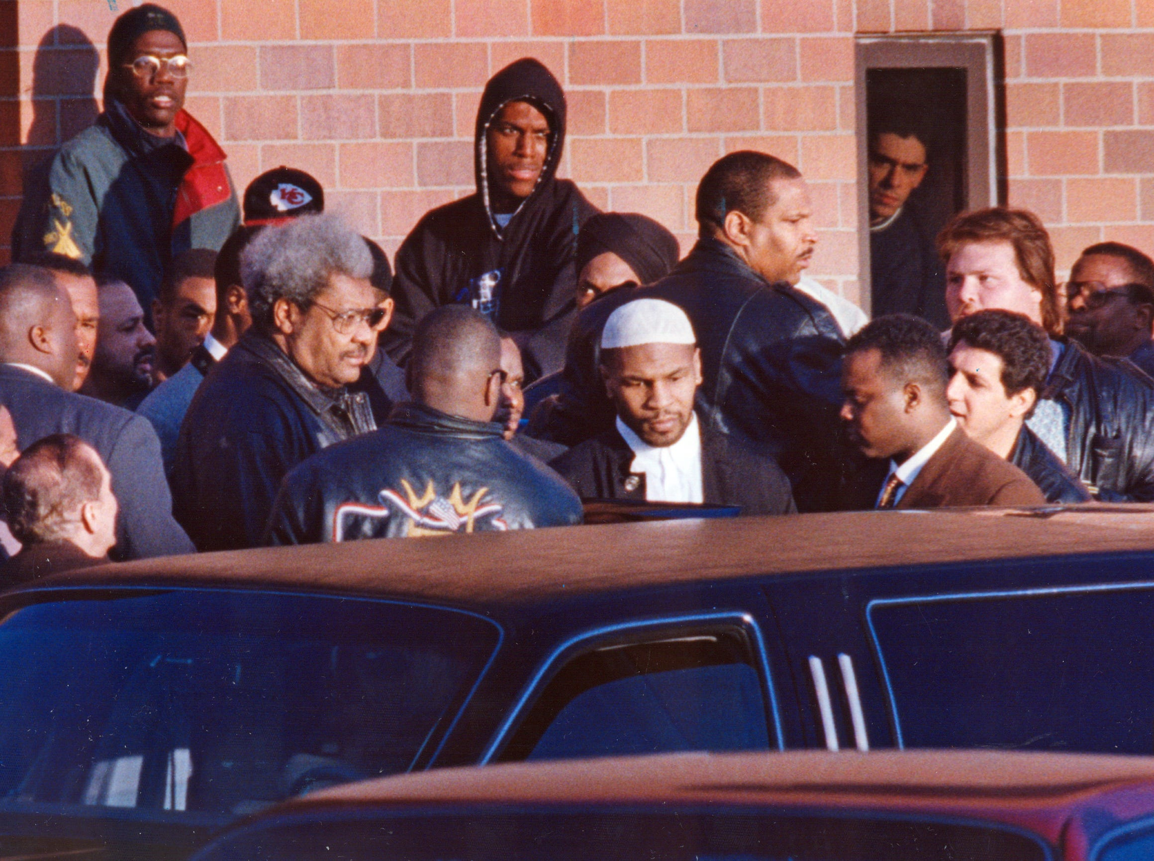 Mike Tyson is released from the Indiana Youth Center near Plainfield, Indiana in March 1995. With him is boxing promoter Don King.