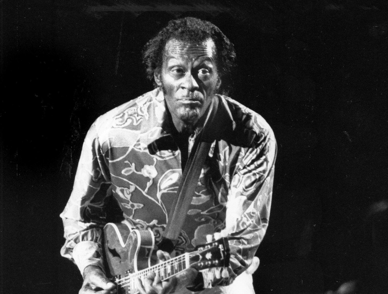 Chuck Berry executes his signature duckwalk during a 1990 performance at Deer Creek Music Center.