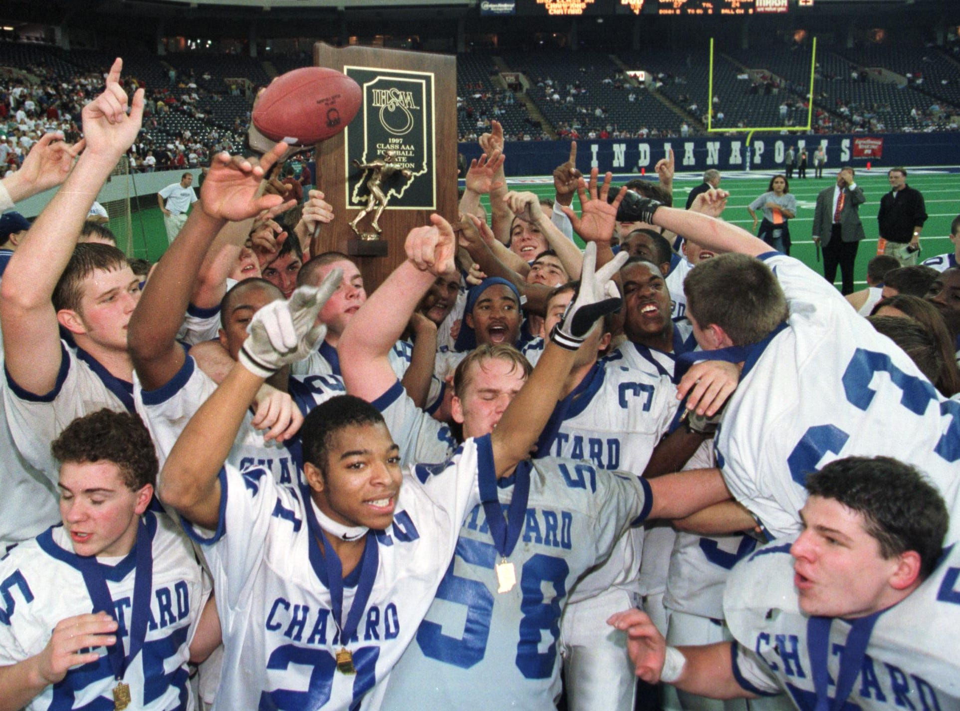 Chatard High School football team members celebrate after defeating Andrean 27-24 in the ISHAA 3A football plyoffs at the Hoosier Dome in 1997.