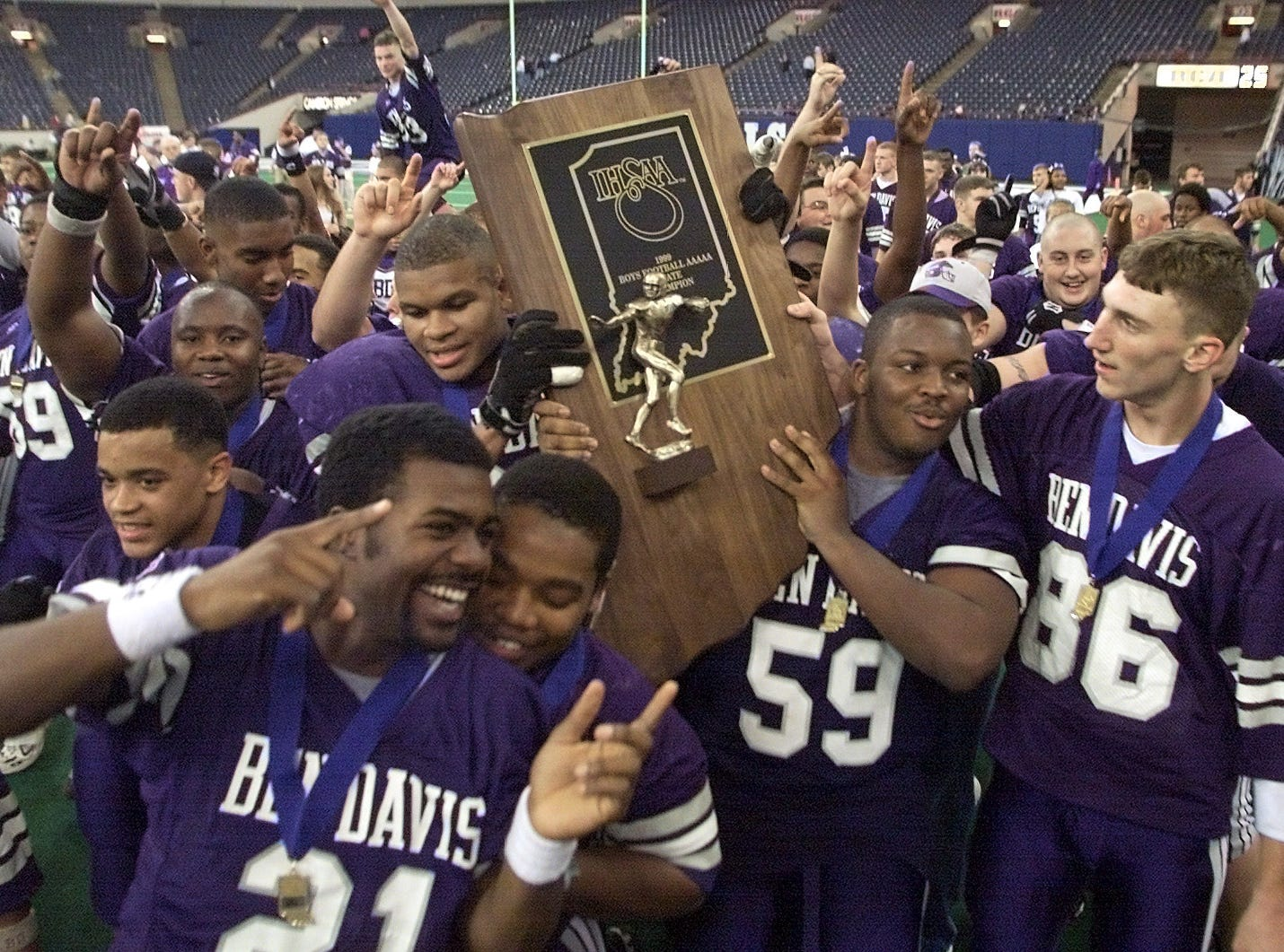 Ben Davis High football players celebrate their  IHSAA 5A Football Championship game on Nov. 27, 1999 at the RCA Dome.