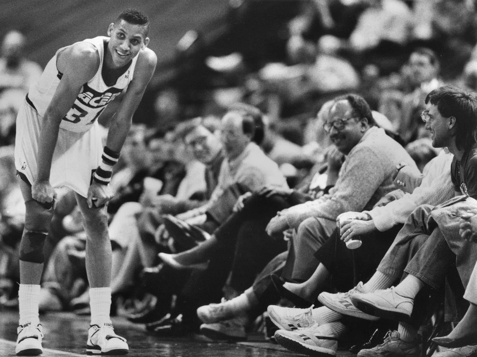 Reggie Miller shares a laugh with fans at MSA during a break in action in the game against Miami on Jan. 29, 1990.