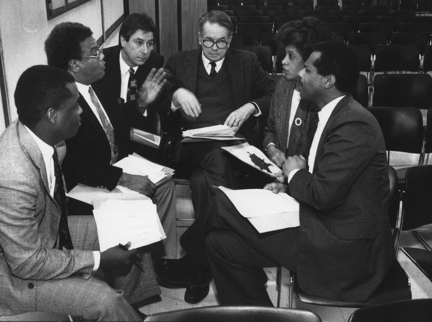 State rep. William Crawford (second from left) makes redistricting suggestions to Indianapolis Board of School Commissioners Dec. 17, 1991.  Left to right: David Girton, Crawford, Donald Payton, Richard Guthrie, Mary Busch and Fred Rice.