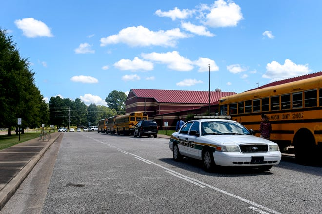 Madison County Sheriff Deputies investigate the scene where a shooting occurred at 2857 Christmasville Road in Jackson, Tenn., on Tuesday, Aug. 28, 2018. Following the report of the shooting, Northeast Middle School, located close to a mile down the road, was put into a soft lock down until the end of the school day.