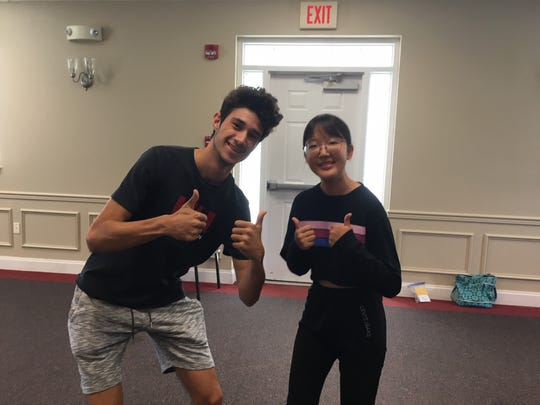 """Marc Caceres and Wooju """"Bella"""" Le endured several canceled flights while trying to get to Knoxville. They ended up on the same plane, and were happy to arrive in town as ready-made friends. August 25, 2018."""