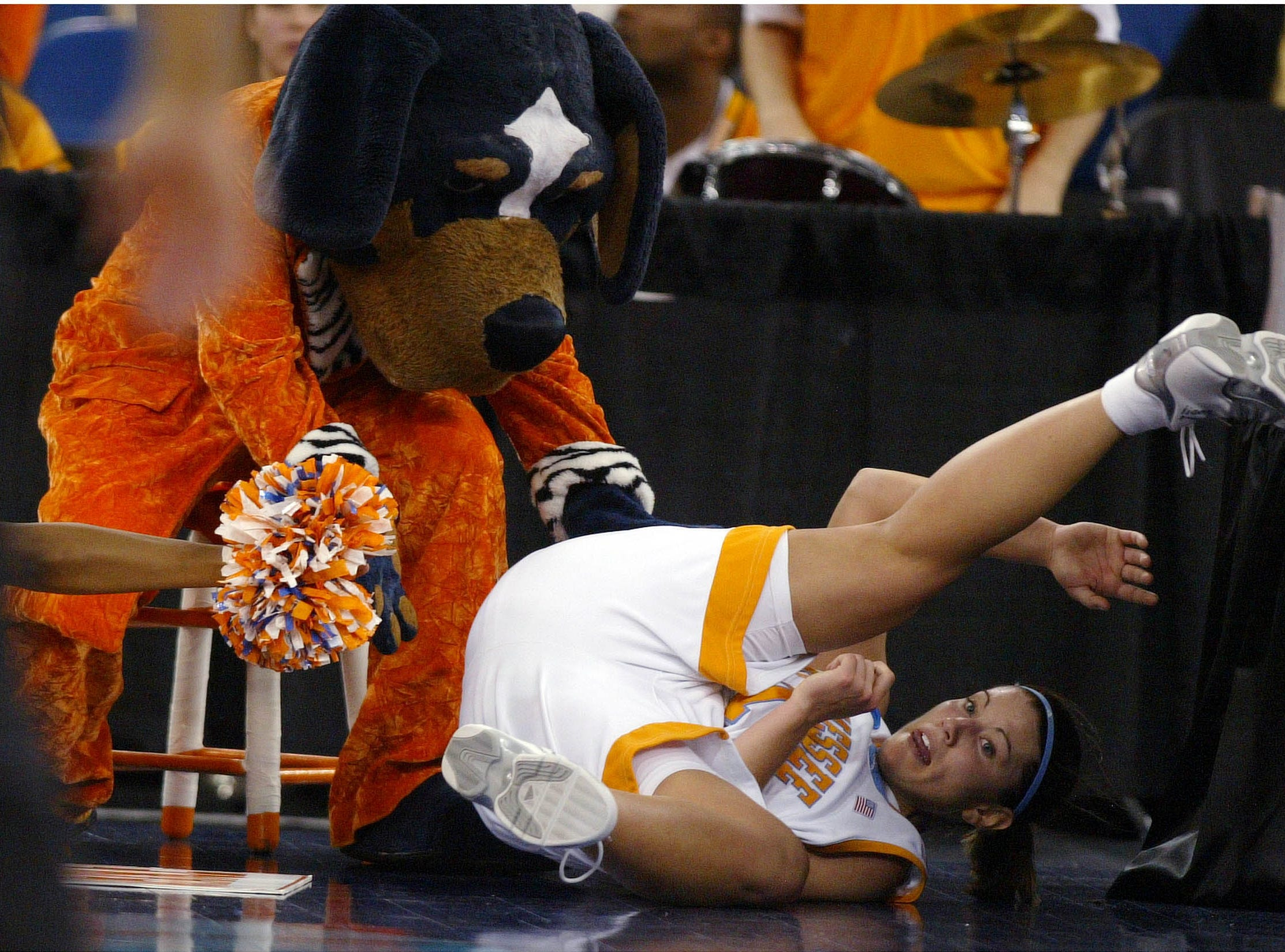 University of Tennessee mascot Smokey tries to catch Lady Vol Shanna Zolman as she falls out of bounds during the team's loss to Michigan State. 04/03/05