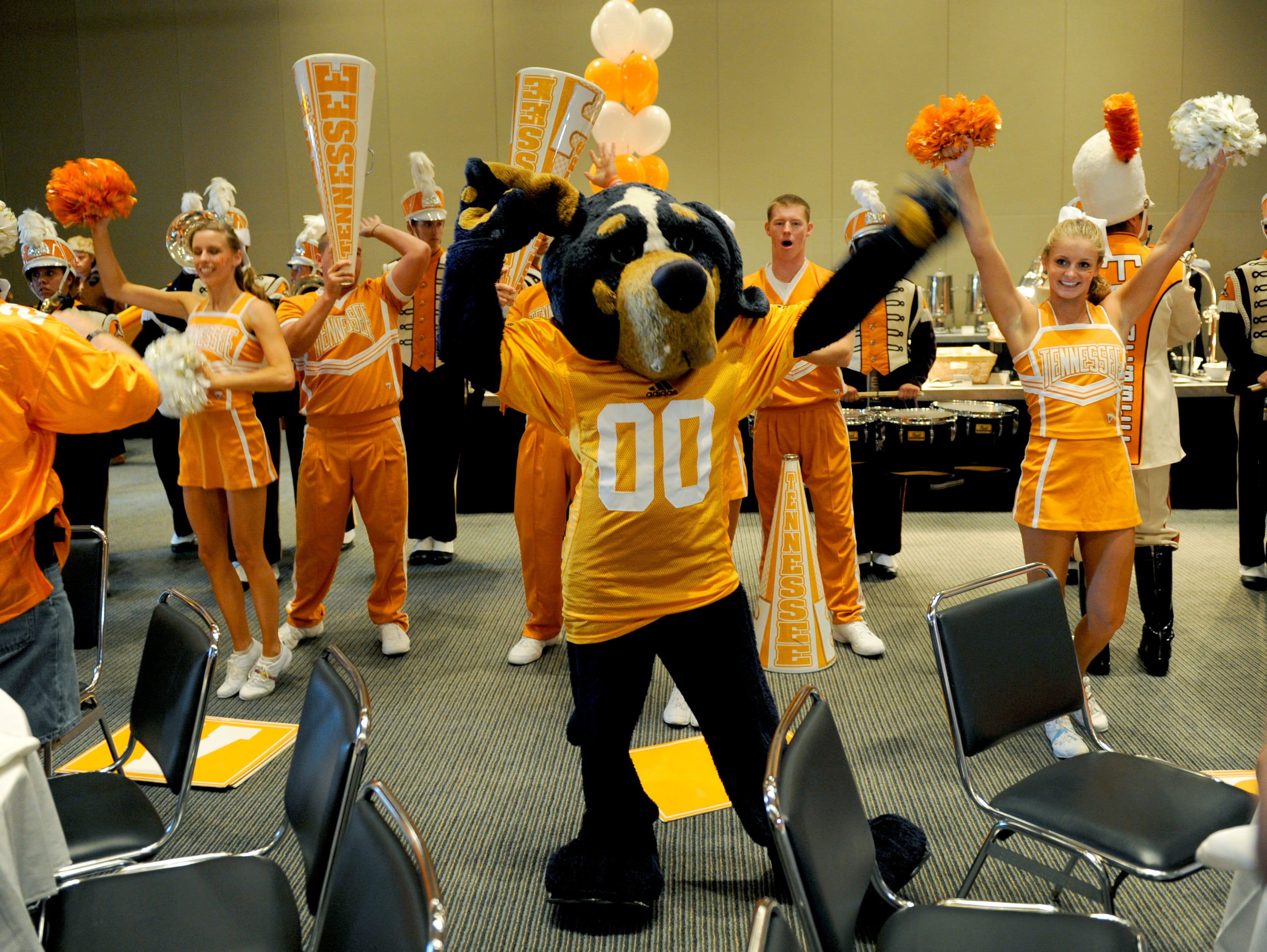 Smokey was joined by the Pride of the Southland Pep Band and the UT cheerleaders to entertain fans during a pre-game rally Friday, Aug. 31, 2012 at the Georgia Dome in Atlanta prior to the Chick-fil-A Kickoff Game.